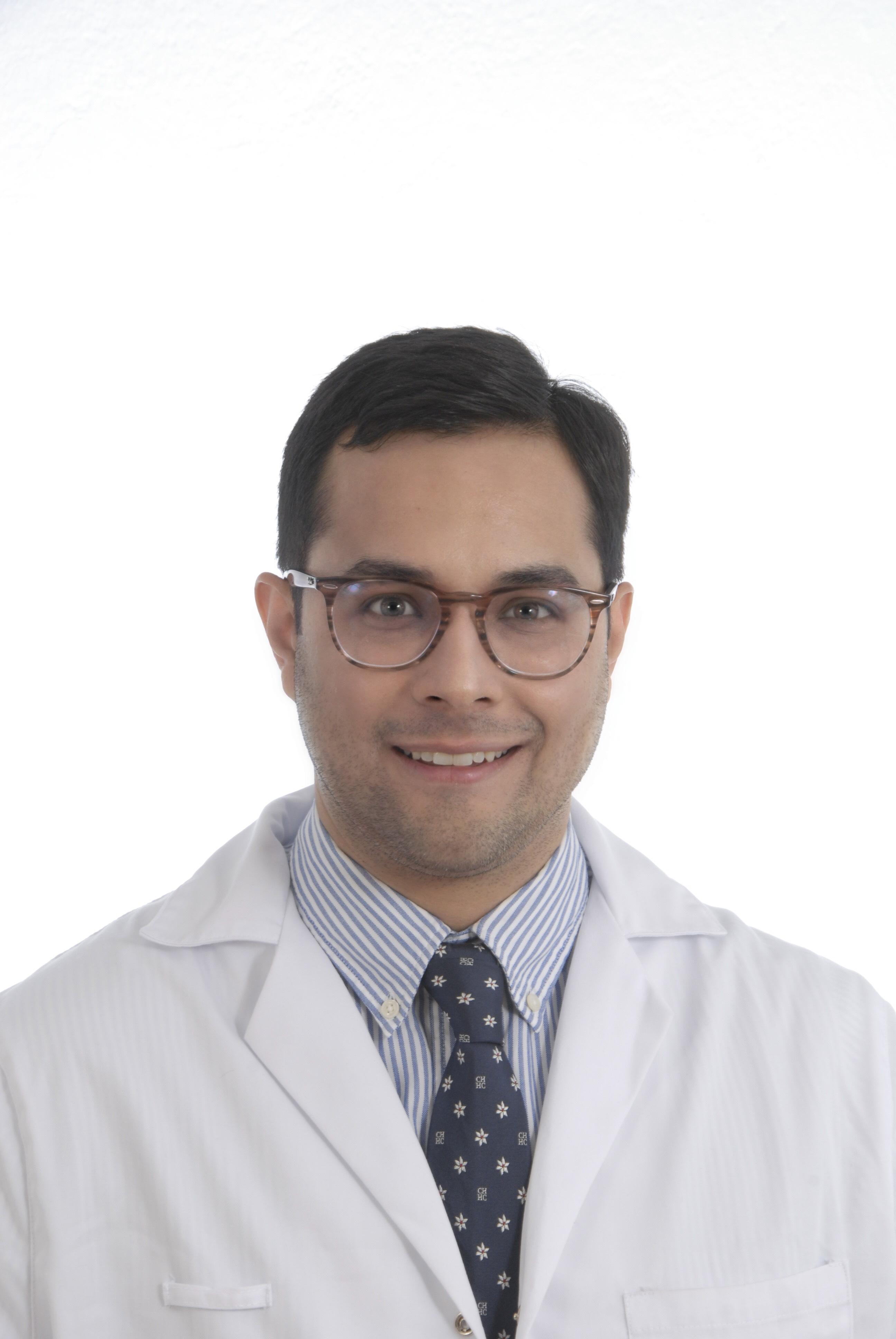 Dr. Carlos González Plata